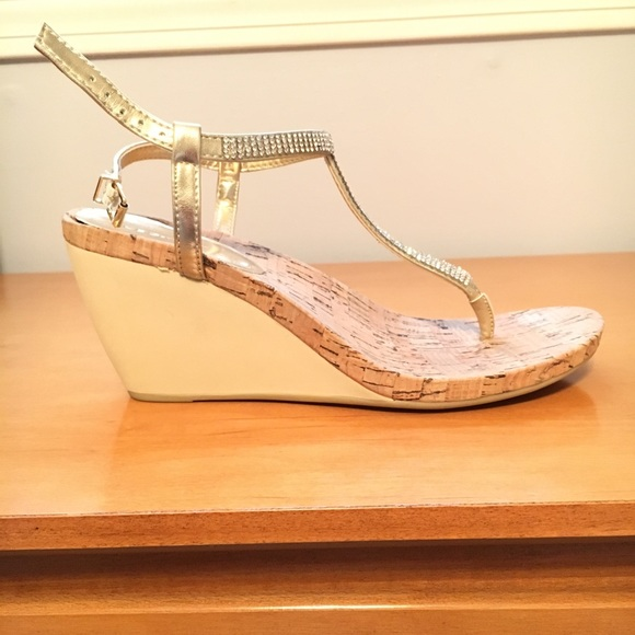 0148ccb94b8 BCBGeneration Shoes - !!!NEVER WORN!!! BCBG Gold and Cork Wedges